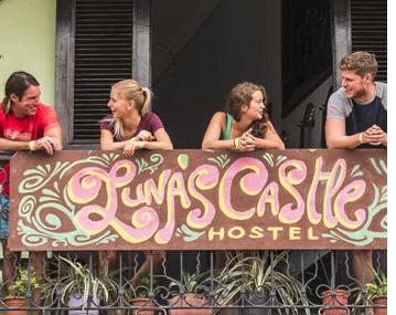 Guests hanging out on balcony at Luna's Castle in Panama City, Panama
