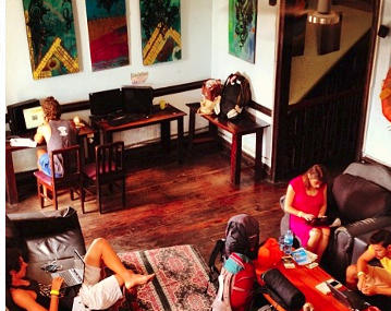 Guests hanging out in common area of Luna's Castle in Panama City, Panama